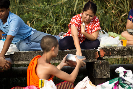 traditions: BANGKOK THAILAND : Many people give alms to a Buddhist monk in traditions festival Thailand Bangkok