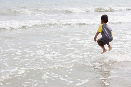rayong: Rayong THAILAND : The child is jumping on the beach at Rayong Thailand Editorial