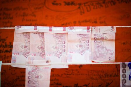 BANGKOK THAILAND : Many Thai cash for donate in Thai temple Bangkok