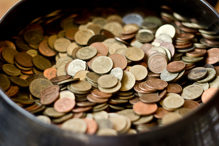 bankroll: The many coin in bowl Stock Photo