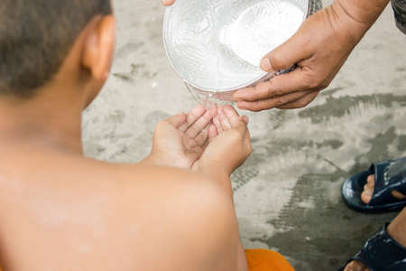 sprinkle: sprinkle water onto The monk in song klan festival Thailand Stock Photo