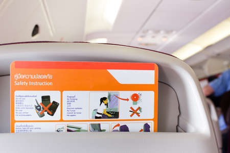 handbooks: safety instruction behind the seat on airplane