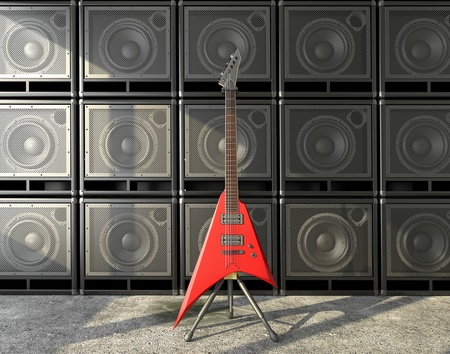 Electric guitar against the speaker