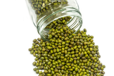 munggo: Mung beans flowing out of glass jar