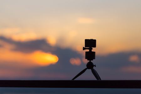 taking video with action camera on handheld stick Stock Photo