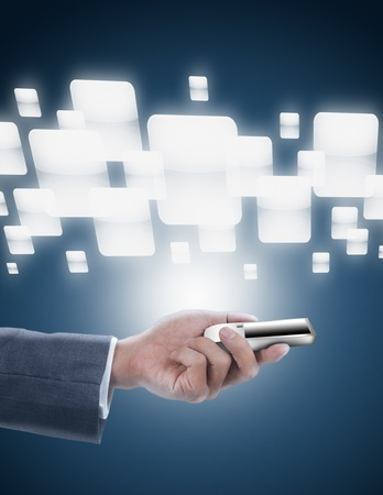 businessman holding mobile phone with multi screen button Stock Photo - 11772124
