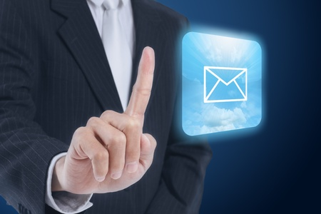 businessman pressing mail icon ,touch screen button photo