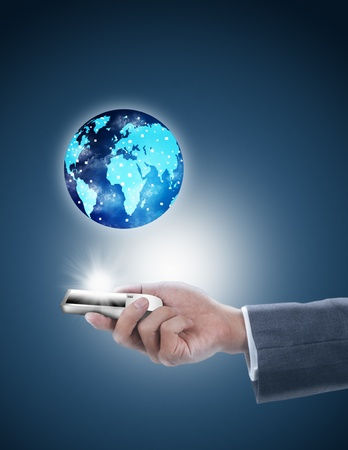businessman holding mobile phone with globe photo