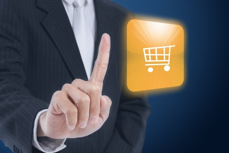 businessman pressing buy now icon touch screen button photo
