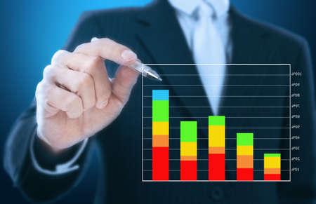 businessman writing graph of stock market Stock Photo - 11824388