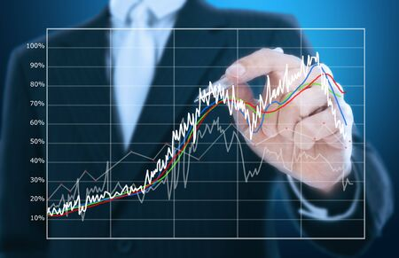company profile:  businessman writing graph of stock market  Stock Photo