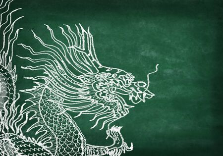 dragon ,drawing with chalk on chalkboard photo