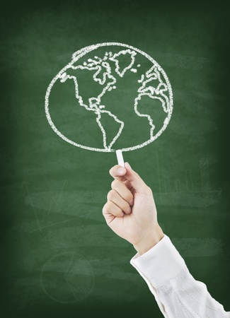 science lesson: Hand drawing world on greenboard Stock Photo