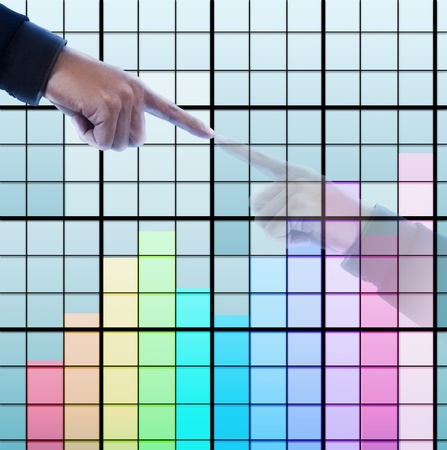 Hand pressing color graph ,reflect in the building Stock Photo - 11824935