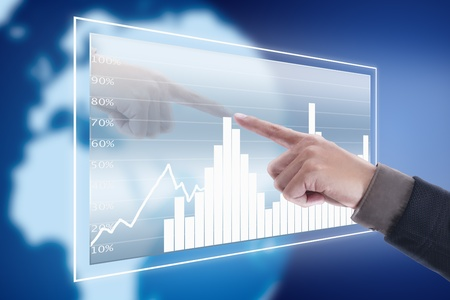 Hand pressing graph screen in cyber space with blue world background photo