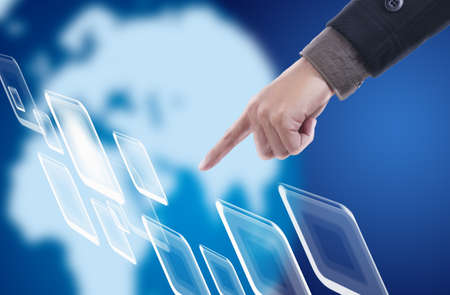Hand pressing touch screen in cyber space with blue world background Stock Photo - 11824679