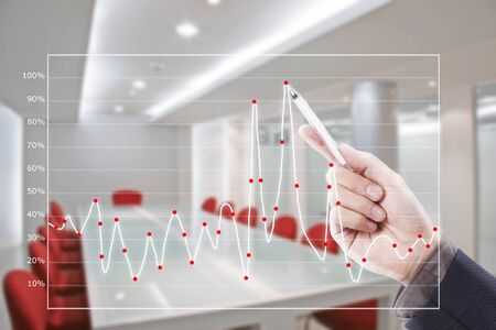 hand writing graph in conference room Stock Photo - 11821344