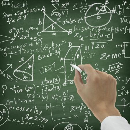 theory: Hand writing maths formula on chalkboard