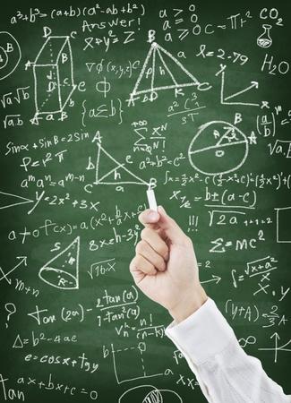 Hand writing maths formula on greenboard Stock Photo - 11825358