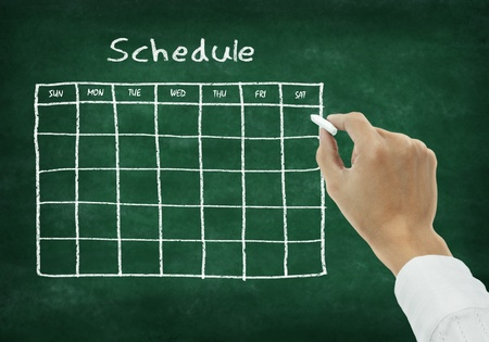 timetable: Hand writing schedule on chalkboard