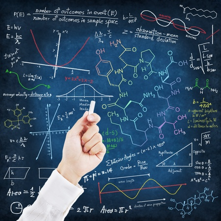 Hand writing science formulas on chalkboard photo