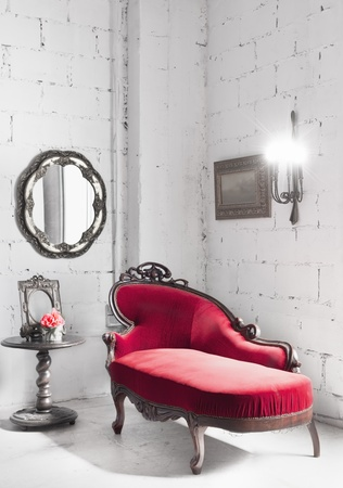 red chair in white room photo