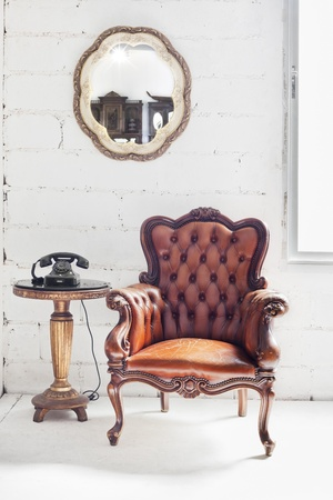 leather chair in white room interior photo