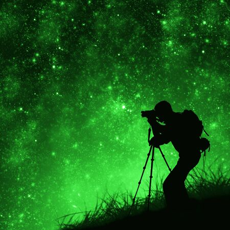 silhouette of photographer shooting stars Stock Photo - 11830655