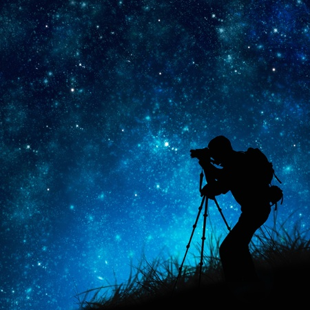silhouette of photographer shooting stars photo