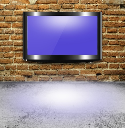 high definition: TV flat screen on brick wall