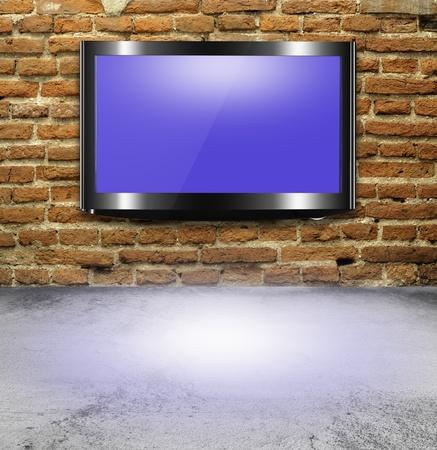 full hd: TV flat screen on brick wall