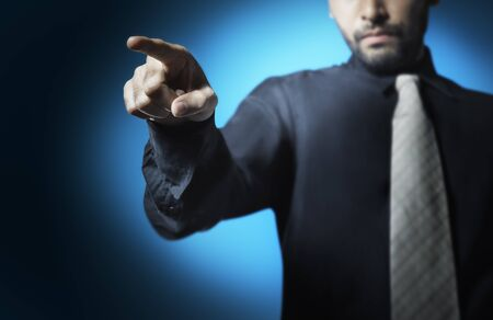 command button: businessman point finger to ordered his teams