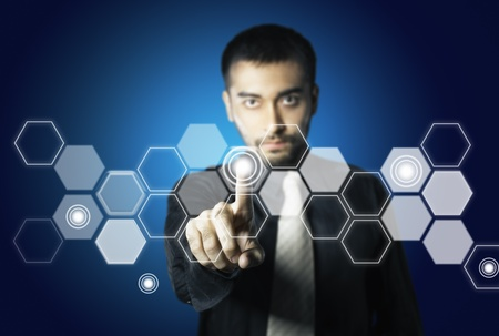 business man touch hexagon screen button photo