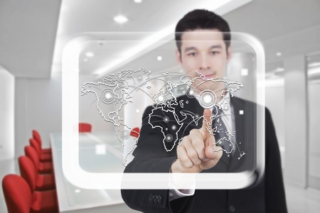 business man touch screen in conference room photo
