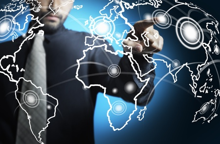 Business man touching world map screen photo