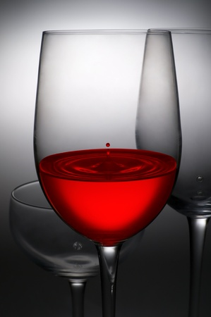 red wine ,drops of wine in wine glasses photo