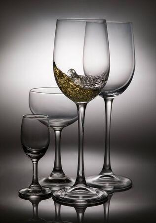 slpashing wine in wine glasses photo