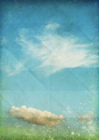 sky and cloud on old grunge paper photo