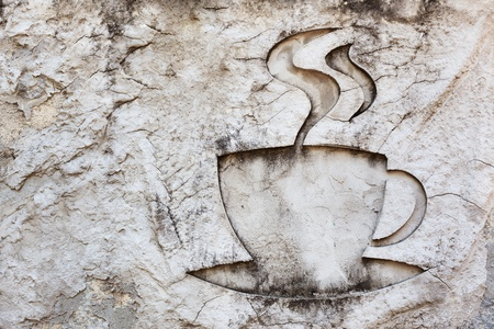 cup of hot drink sign ,coffee and tea ,carving on stone  photo