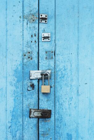 ancient blue door with iron door locked Stock Photo - 12536680