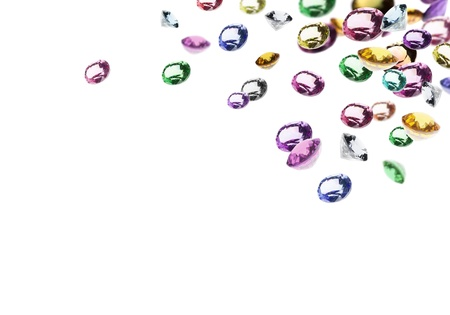colorful gems falling in white background photo