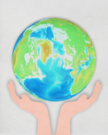 hand holding globe ,paper art design ,save the earth concept photo