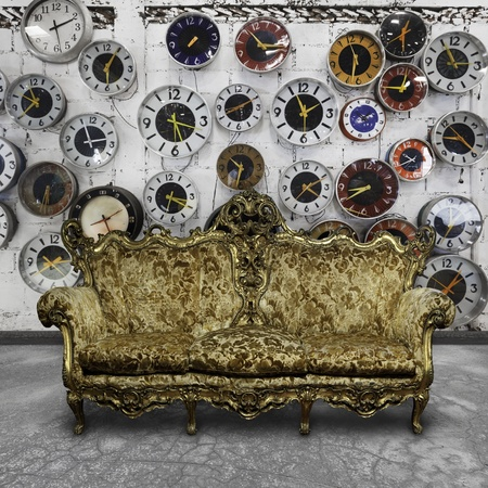 luxury sofa  in white room with retro clocks on the wall Stock Photo - 13152891