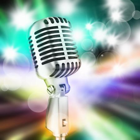 歌: 舞台照明のバック グラウンドでマイク 写真素材