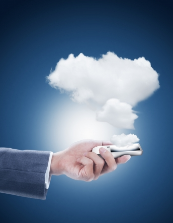 hand holding mobile phone with cloud computing photo