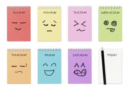 weekly calendar with face drawing  ,routine work concept Stock Photo