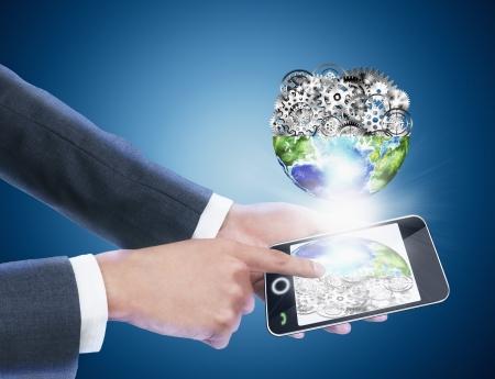 businessman holding mobile phone ,blue background photo
