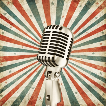vintage microphone on grunge ray background photo