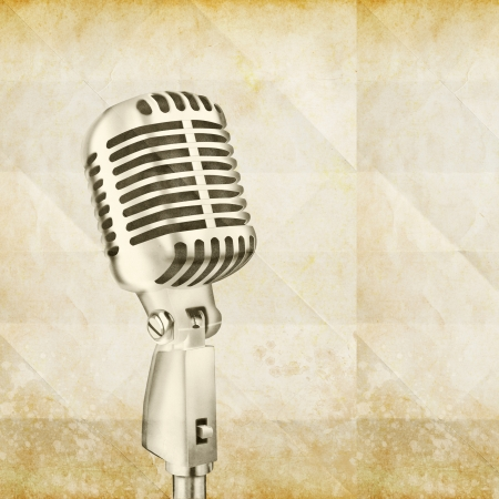 voices:  vintage microphone on old paper Stock Photo