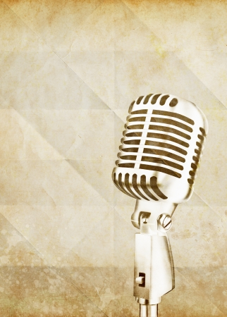 voices: vintage microphone on old paper
